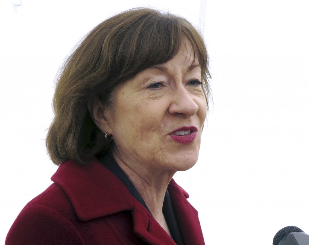 Sen. Susan Collins speaks to the media outside Bath Iron works, where she spoke during a ceremony marking construction of a new warship, Friday, Nov.