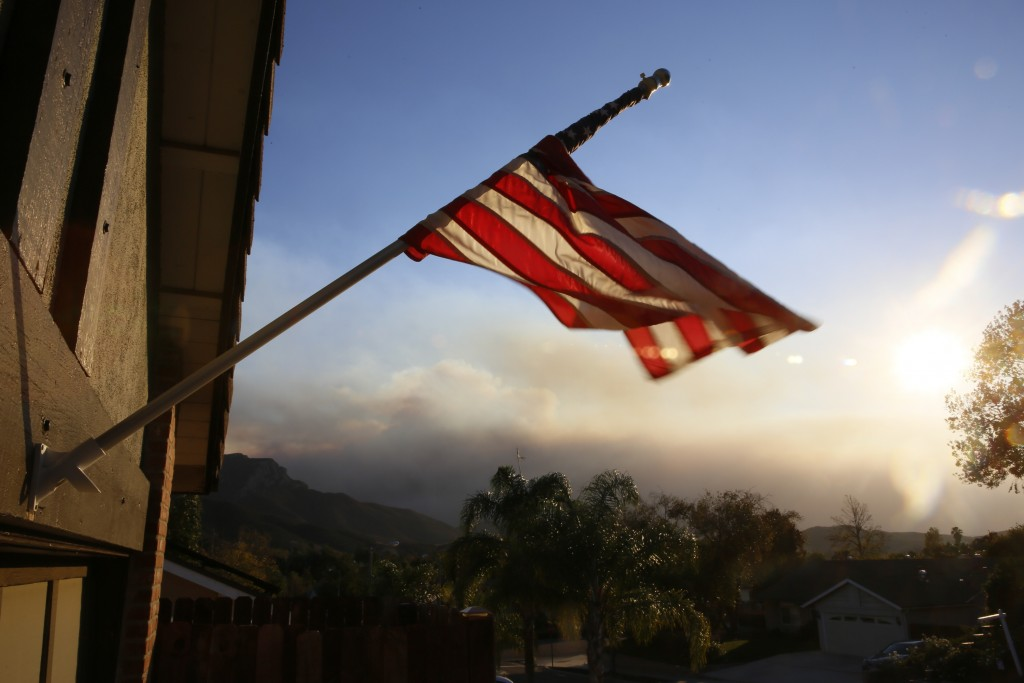 A flag is seen partially wrapped up in its pole due to heavy winds, outside the home of the ex-Marine Ian David Long, who killed 12 people at a countr