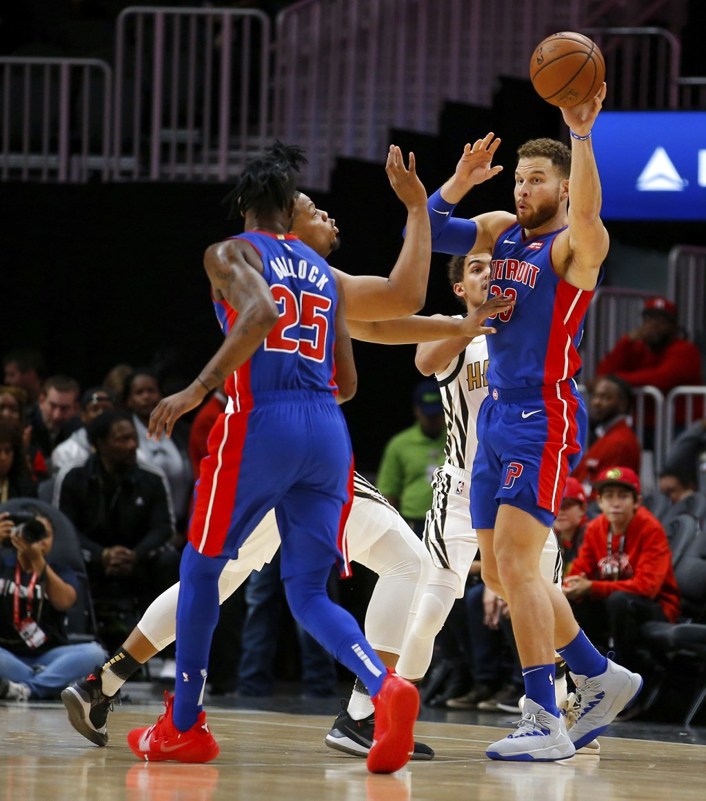 Detroit Pistons forward Blake Griffin (23) passes to guard Reggie Bullock (25) during the first half of the team's NBA basketball game against the Atl
