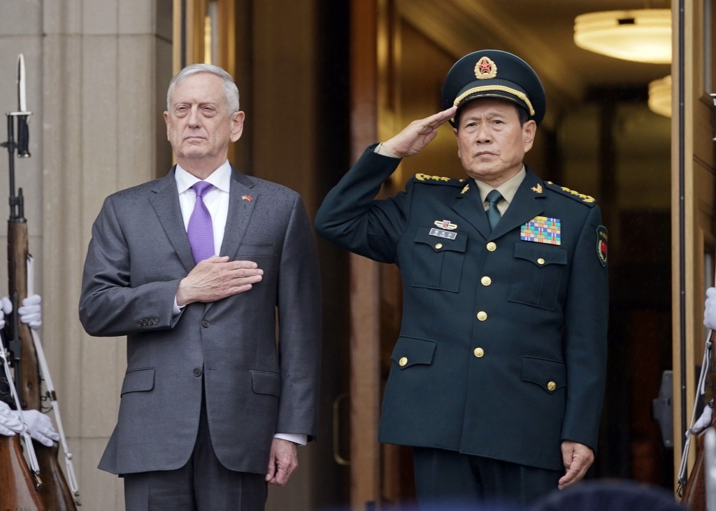 Defense Secretary Jim Mattis and Chinese Minister of Defense General Wei Fenghe, stand as the national anthems are played during an welcome ceremony a...