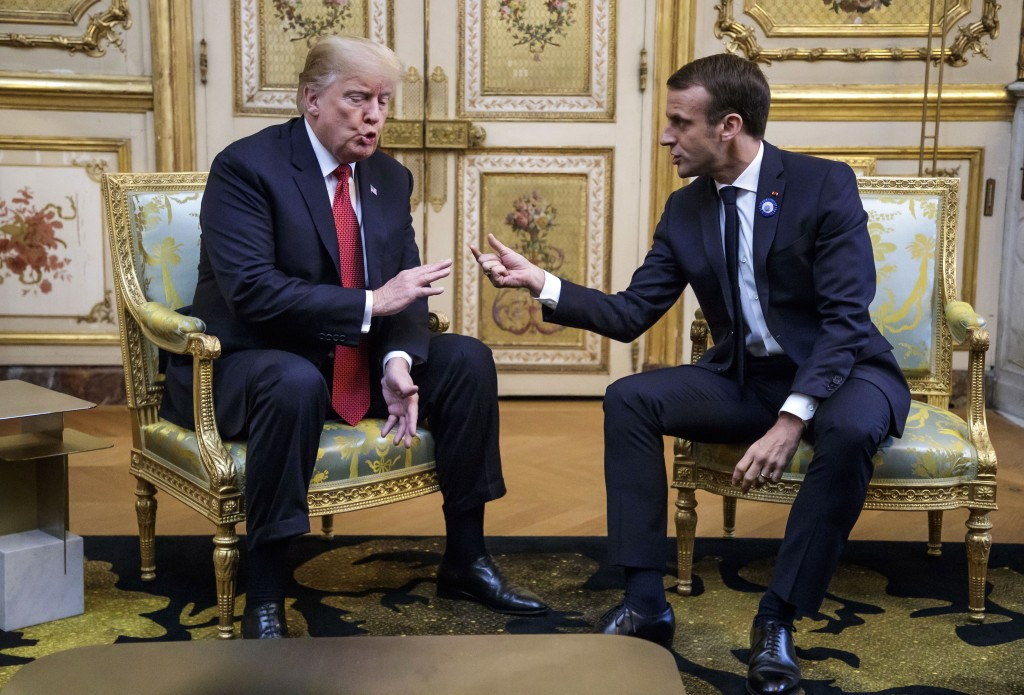 French President Emmanuel Macron and U.S President Donald J. Trump, left, meet at the Elysee palace in Paris, Saturday, Nov.10 2018. Trump is joining