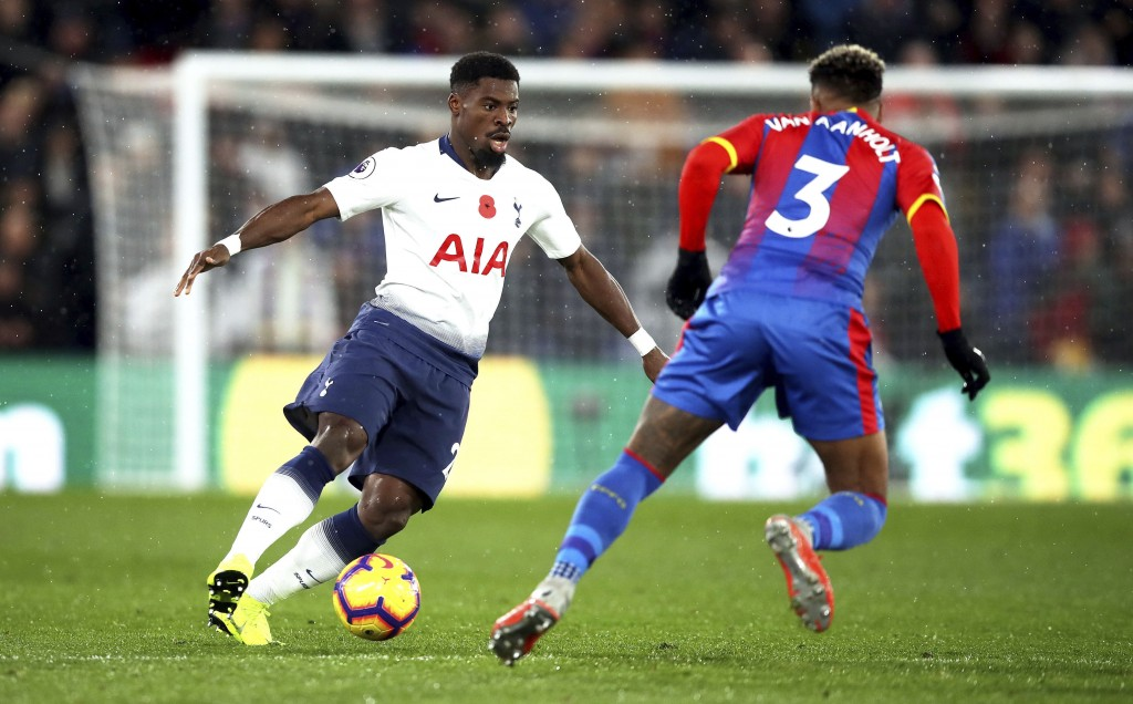 Tottenham Hotspur's Serge Aurier, left, and Crystal Palace's Patrick van Aanholt battle for the ball during their English Premier League soccer match