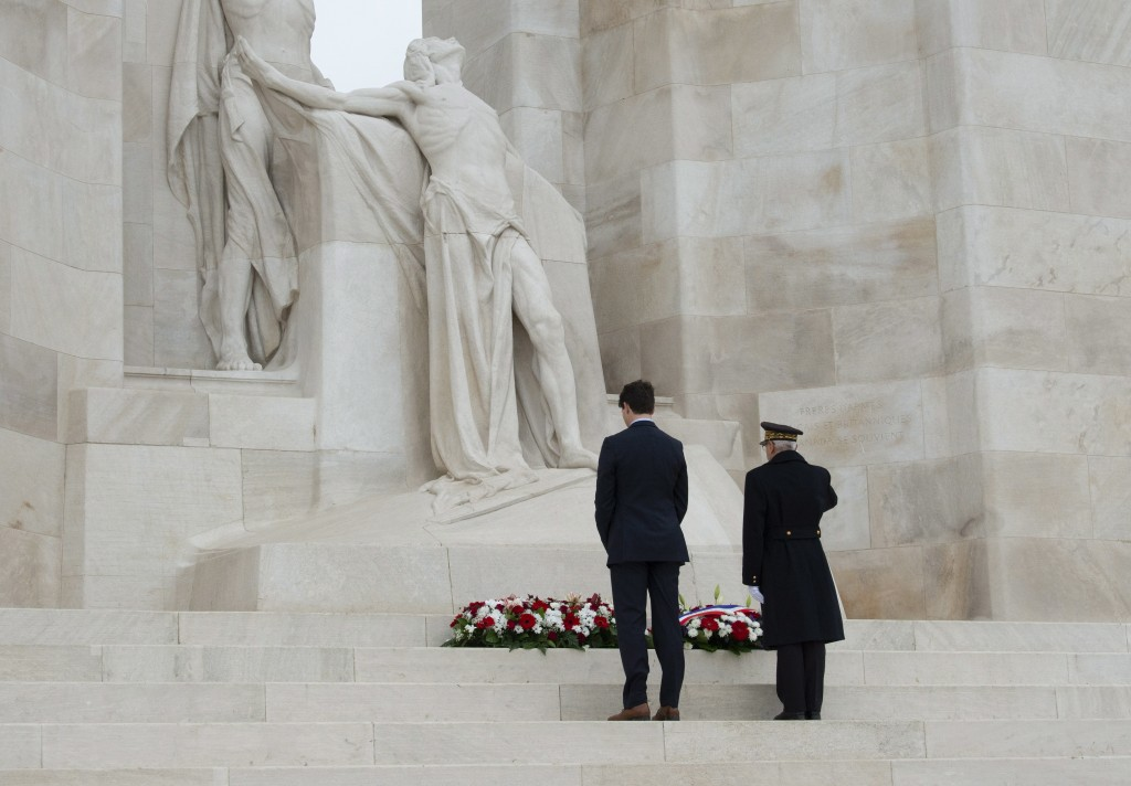 Canadian Prime Minister Justin Trudeau pauses as he lays a wreath on the Canadian National Vimy Memorial Saturday, Nov.  10, 2018 at Vimy Ridge, Franc