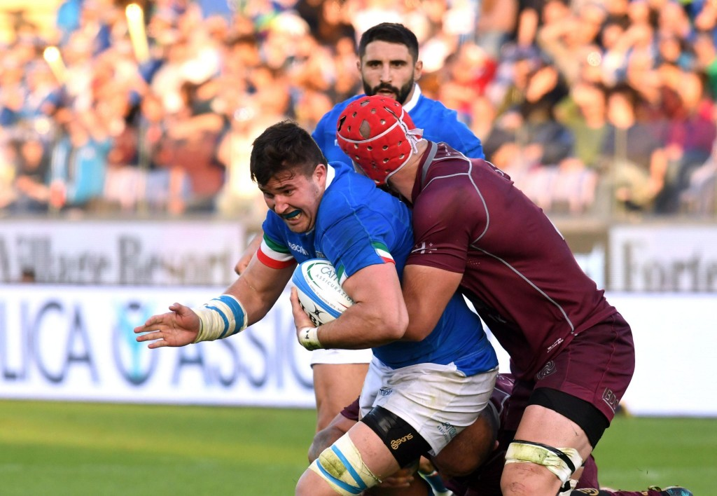Italy's Sebastian Negri, left, battles for the ball with Georgia's Nodar Cheishvili during an international union rugby match between Italy and Georgi