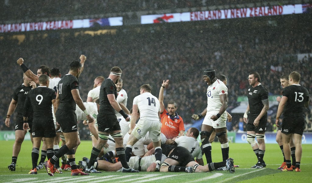 England players celebrate after England's Dylan Hartley scored a try during the rugby union international match between England and New Zealand at Twi