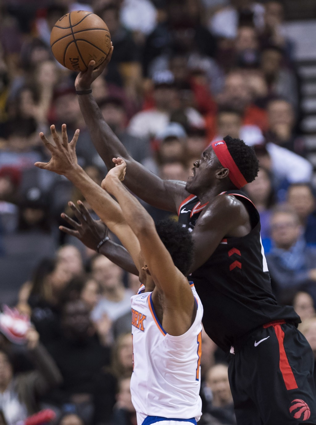 Toronto Raptors forward Pascal Siakam (43) drives to the net past New York Knicks guard Allonzo Trier (14) during second half NBA basketball action in