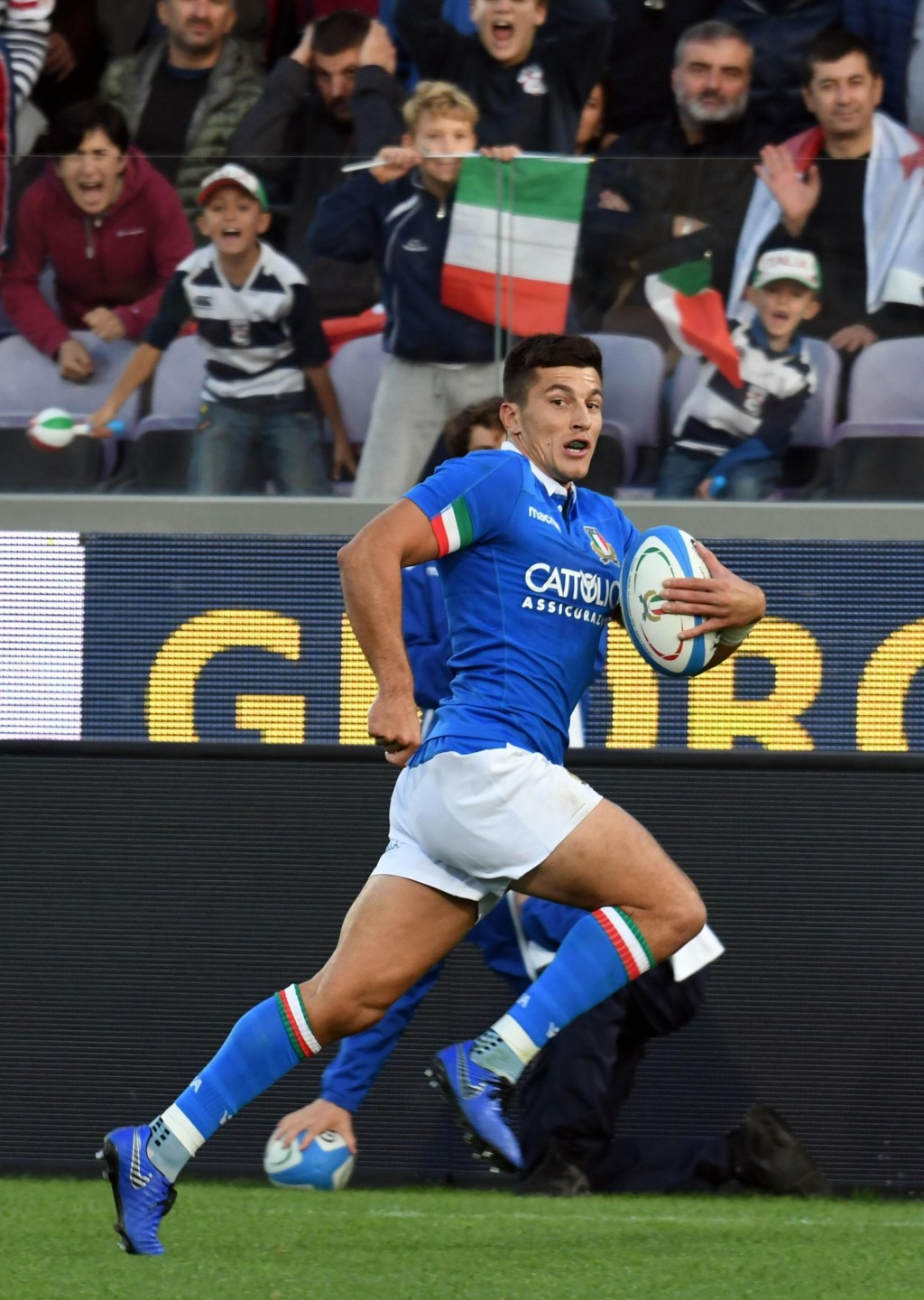 Italy's Tommaso Allan runs on his way to score a try during an international union rugby match between Italy and Georgia, at the Artemio Franchi stadi