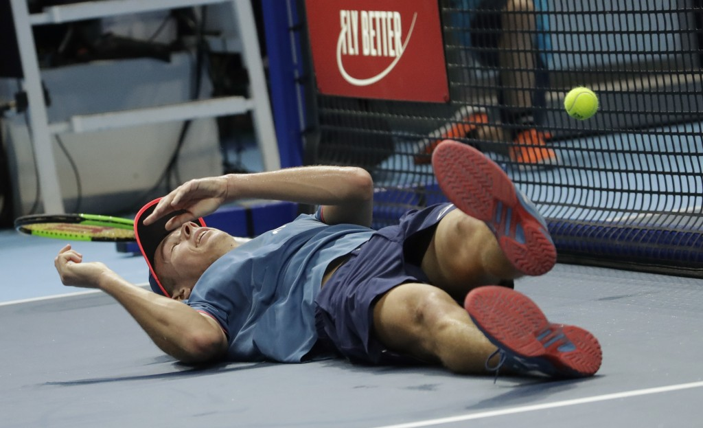 Alex De Minaur, of Australia, falls as he plays against Stefanos Tsitsipas of Greece, during the ATP Next Gen tennis tournament final, at the Rho fair
