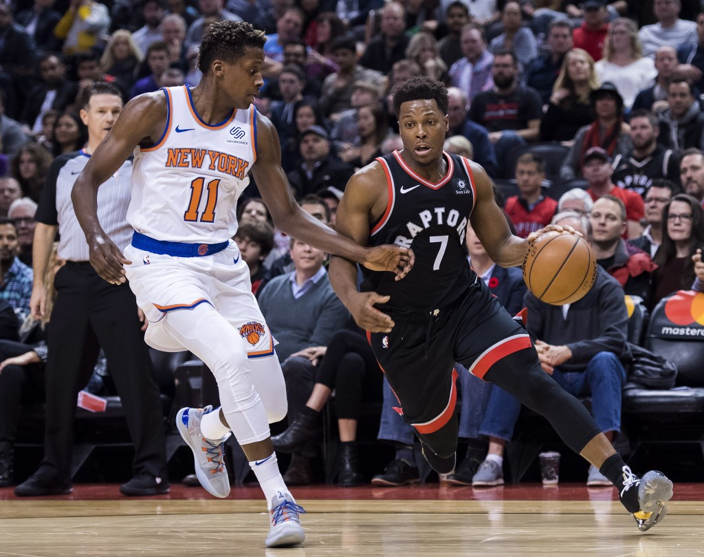 Toronto Raptors guard Kyle Lowry (7) protects the ball from New York Knicks guard Frank Ntilikina (11) during first half NBA basketball action in Toro