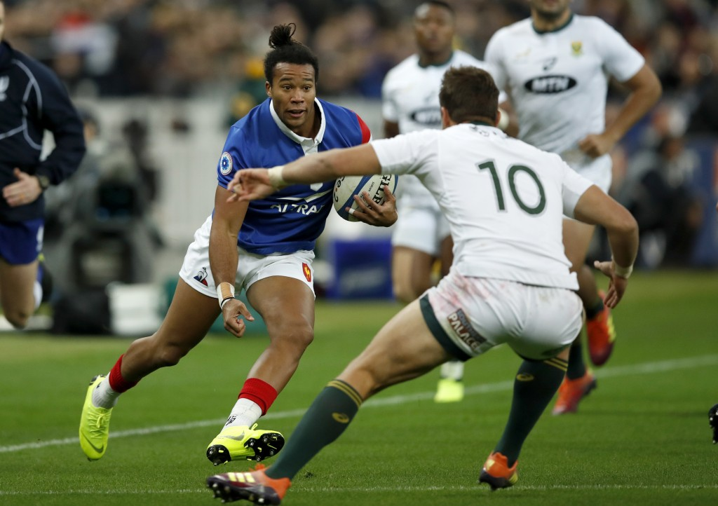 France's Teddy Thomas runs at South Africa's Handre Pollard during their rugby union international at the Stade de France in Paris, France, Saturday,