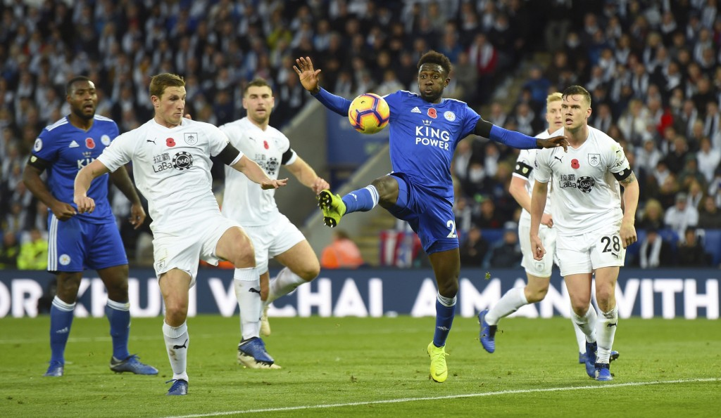 Leicester City's Wilfred Ndidi, second right, controls the ball in the air during the English Premier League soccer match between Leicester City and B