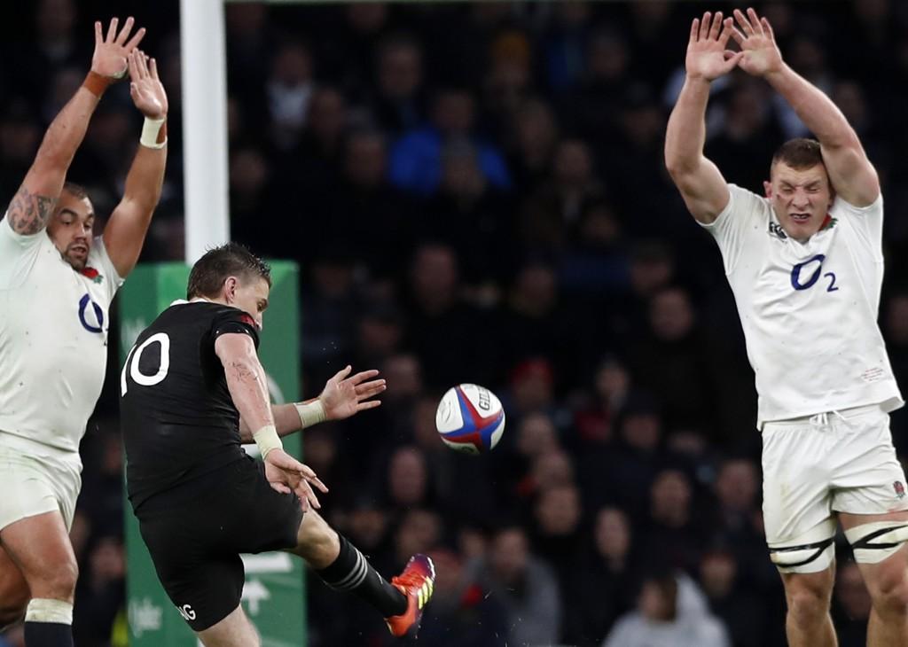 New Zealand's Beauden Barrett, center, scores a drop goal during the rugby union international match between England and New Zealand at Twickenham sta
