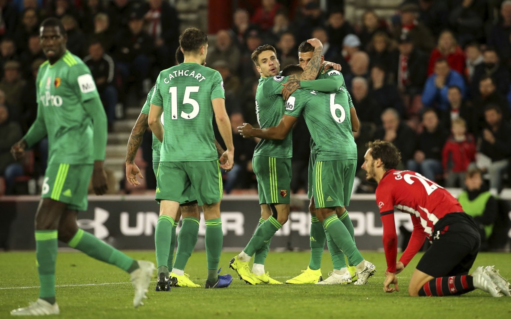 Watford's Jose Holebas, second right, celebrates scoring his side's first goal of the game with team mates during the English Premier League soccer ma