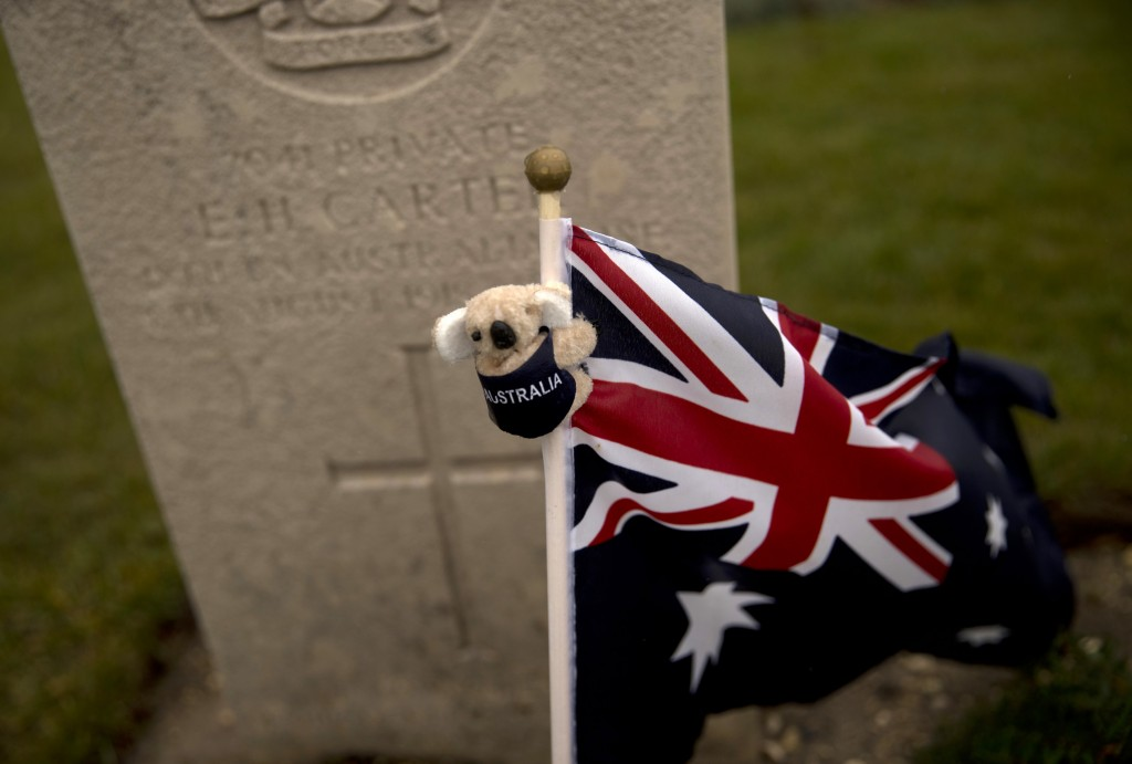 An Australian flag with a koala bear adorns a grave of a soldier at the World War I Australian National Memorial in Villers-Bretonneux, France, Saturd