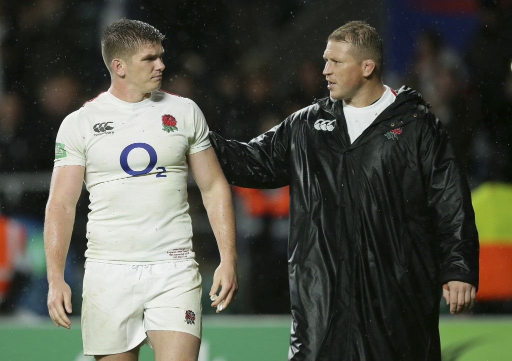 England's Owen Farrell, left, and Dylan Hartley after the rugby union international match between England and New Zealand at Twickenham stadium in Lon...