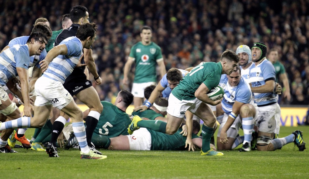 Ireland's Luke McGrath breaks through to score a try during the rugby union international match between Ireland and Argentina, at the Aviva Stadium in