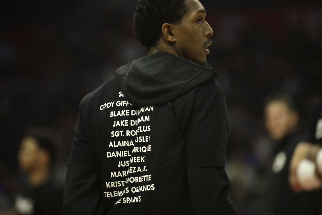 Los Angeles Clippers' Lou Williams wears a T-shirt bearing the names of the 12 victims killed in Wednesday night's shooting at a country bar in Thousa