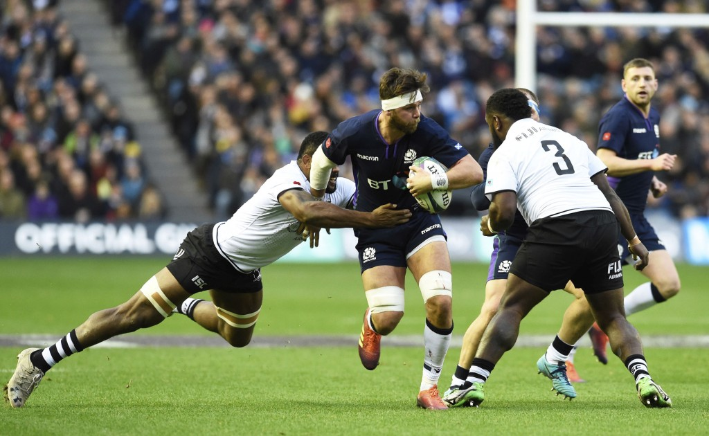Ryan Wilson of Scotland is tackled by Peceli Yato of Fiji, left and Manasa Saulo, right, during the International Rugby match between Scotland and Fij