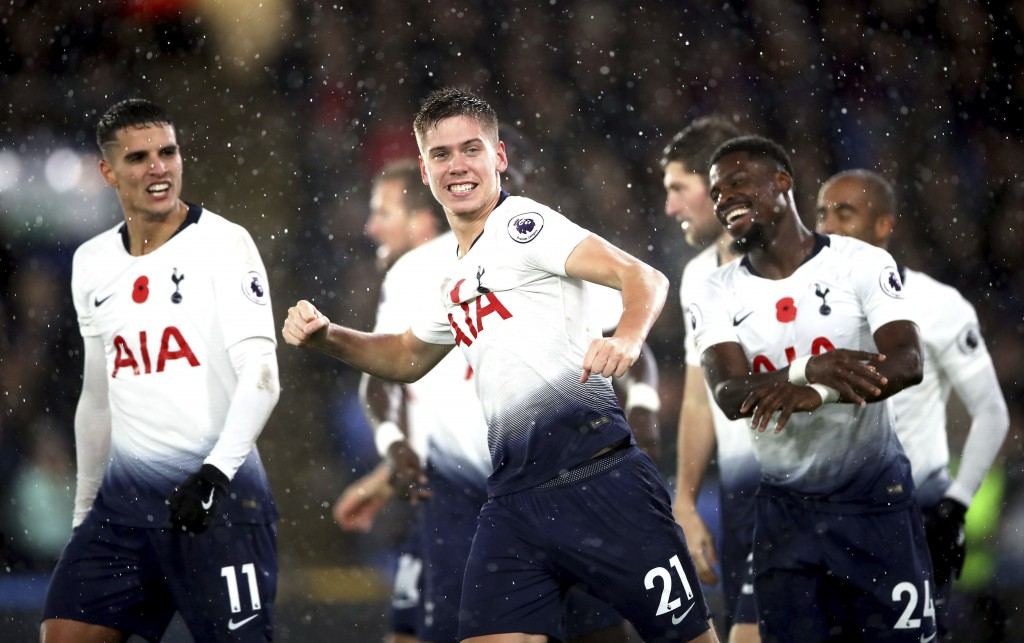 Tottenham Hotspur's Juan Foyth, center, celebrates scoring his side's first goal of the game during their English Premier League soccer match against
