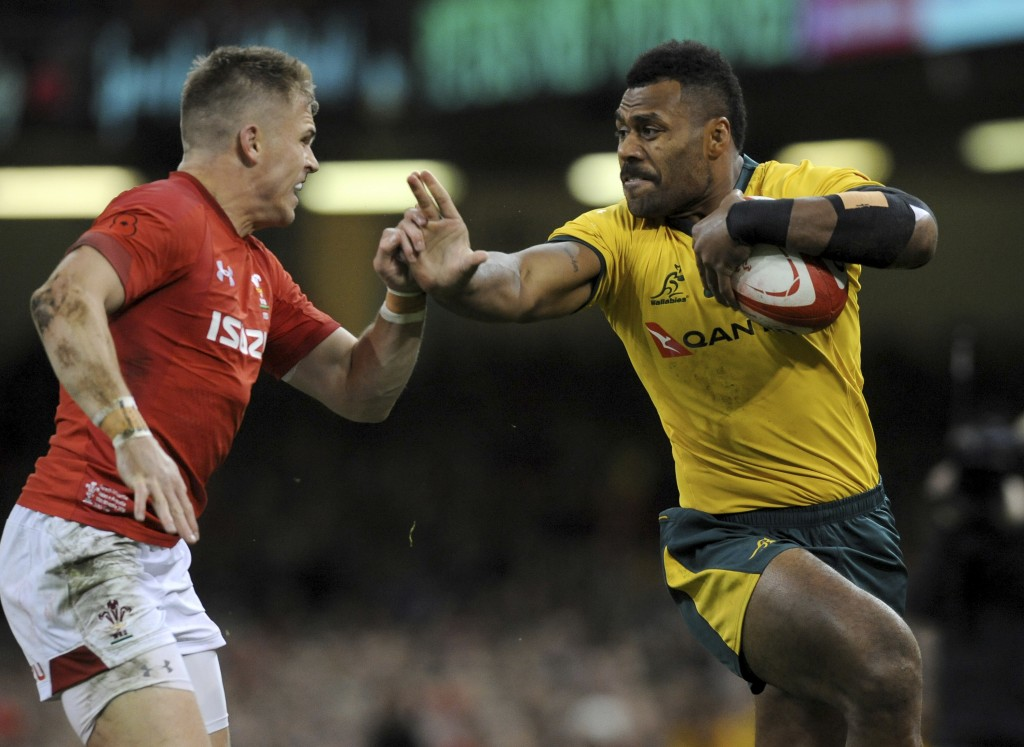 Australia's Samu Kerevi, right, attempts to fend say the tackle of Wales Gareth Anscombe during the rugby union international match between Wales and ...