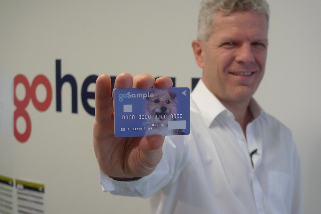 In this Oct. 17, 2018 photo, Alex Zivoder, CEO of Gohenry, a digital banking startup aimed at children, holds up a sample of the prepaid debit cards t...