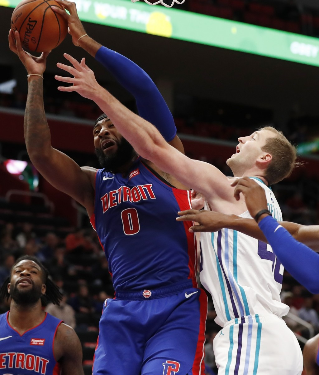 Charlotte Hornets center Cody Zeller (40) reaches in as Detroit Pistons center Andre Drummond (0) pulls down a rebound during the first half of an NBA