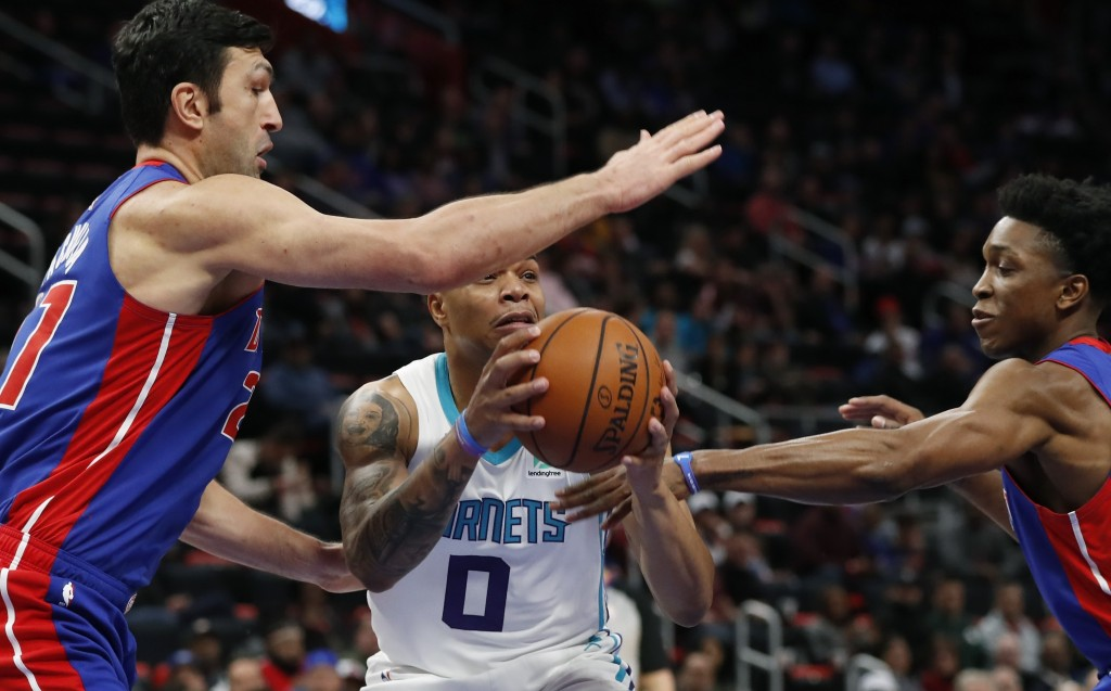 Detroit Pistons center Zaza Pachulia, left, and forward Stanley Johnson defend as Charlotte Hornets forward Miles Bridges (0) looks to pass during the