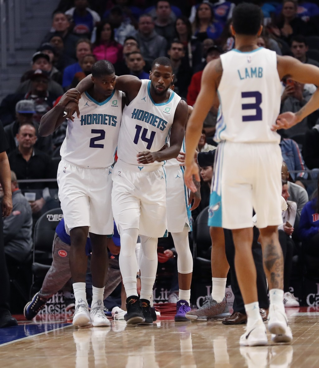 Charlotte Hornets forward Michael Kidd-Gilchrist (14) is helped off the court after a play during the first half of an NBA basketball game against the
