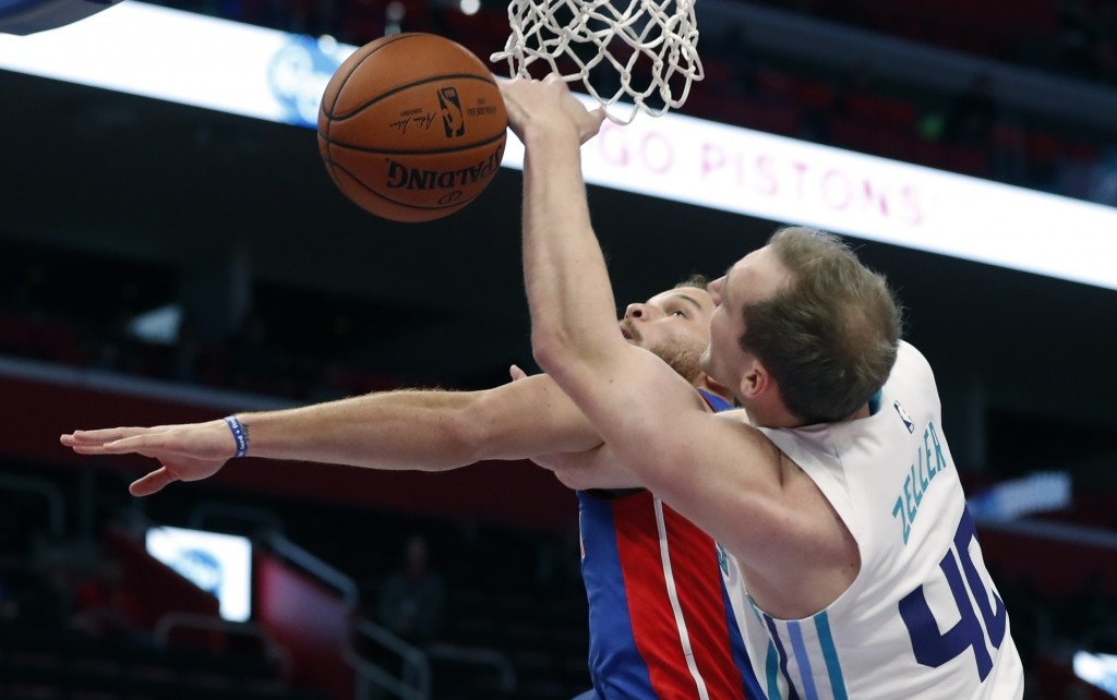 Detroit Pistons forward Blake Griffin and Charlotte Hornets center Cody Zeller (40) reach for the rebound during the first half of an NBA basketball g