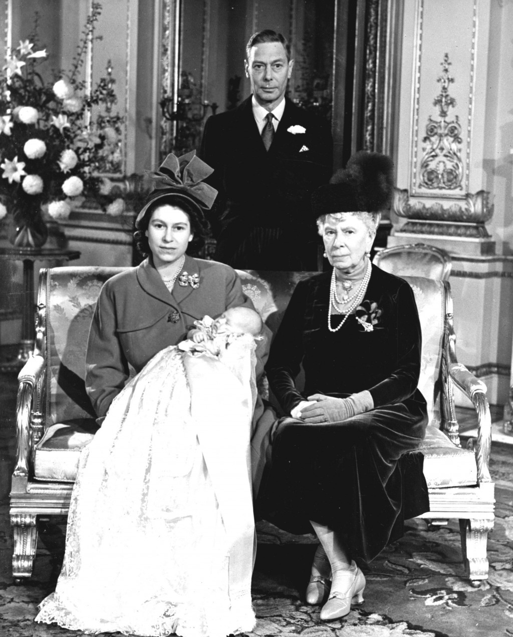FILE - In this Dec. 15, 1948 file photo, Britain's Queen Elizabeth pictured with her first son, Prince Charles, her grandmother Queen Mary and father