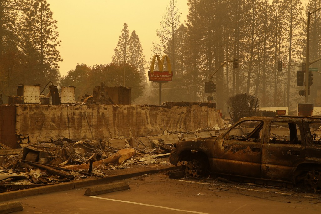 A sign still stands at a McDonald's restaurant burned in the Camp Fire, Monday, Nov. 12, 2018, in the northern California town of Paradise. (AP Photo/