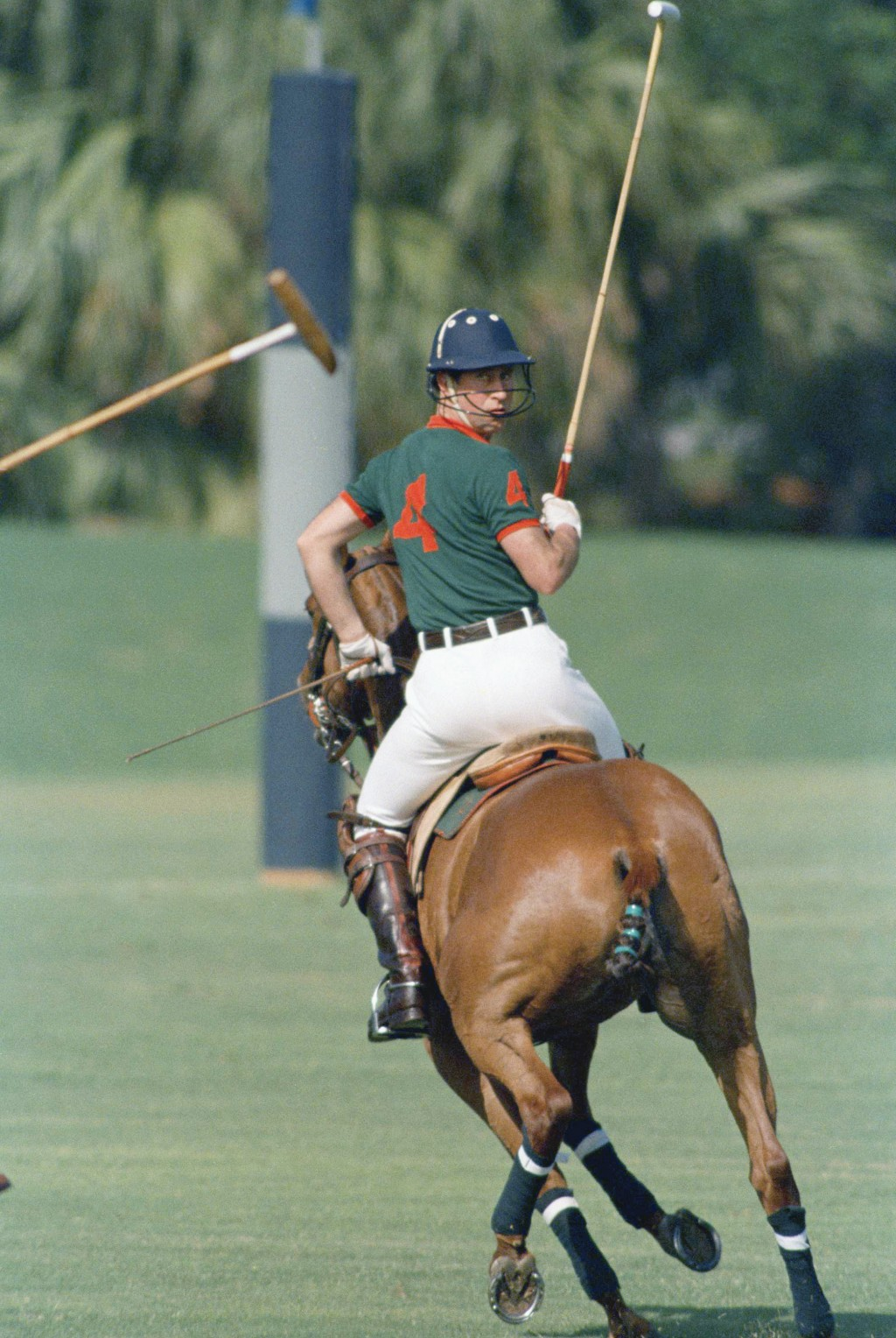 FILE - In this Feb. 18, 1989 file photo Prince Charles looks over his shoulder as he plays in the first Prince of Wales Cup polo match at the Windsor