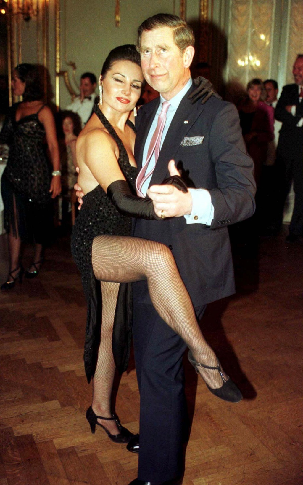 FILE - In this Tuesday March 9, 1999 file photo Britain's Prince Charles dances the tango with Adriana Vasile, at the Presidents Dinner in Buenos Aire