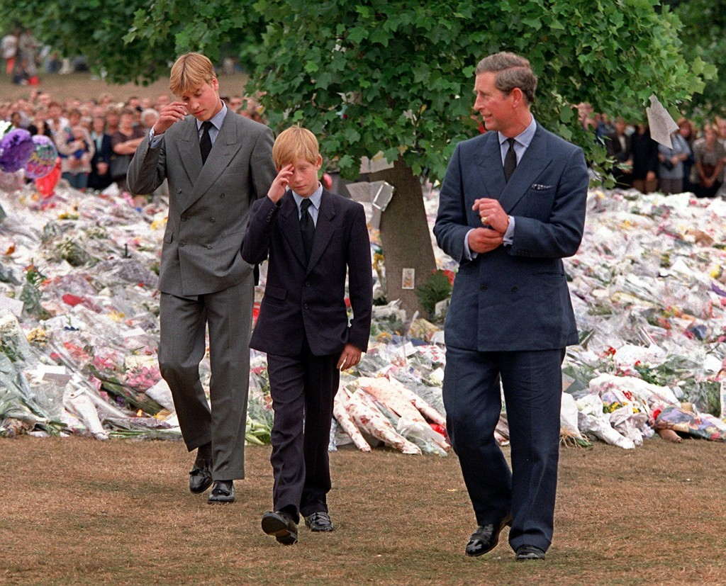 FILE - In this Friday, Sept. 5, 1997 file photo Britain's Prince Charles, right, accompanies his sons Prince William, left and Prince Harry after they