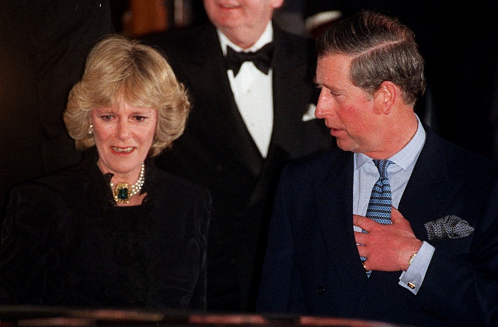 FILE - In this Thursday, Jan. 28, 1999 file photo, Britain's Prince Charles and his companion Camilla Parker Bowles leave the Ritz Hotel in London, th