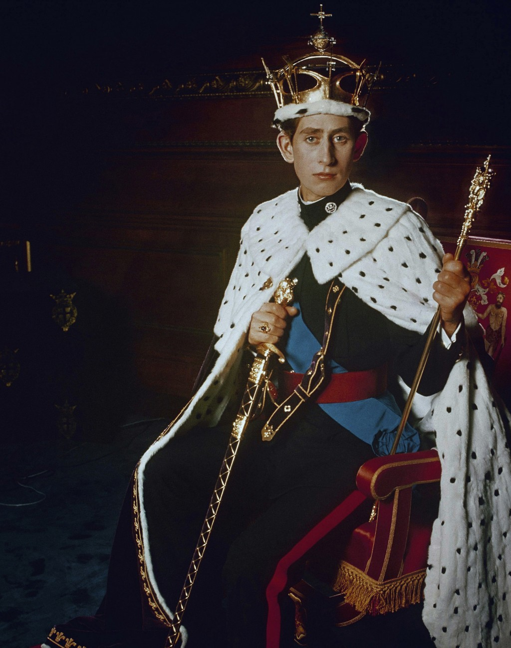 FILE - In this 1969 file photo, Britain's Prince Charles, poses for a photo dressed in his investiture regalia as Prince of Wales.  Prince Charles tur