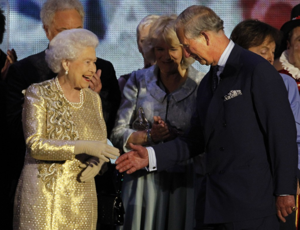 FILE - In this Monday, June 4, 2012 file photo Britain's Queen Elizabeth II shakes the hand of her son Prince Charles at the end of the Queen's Jubile