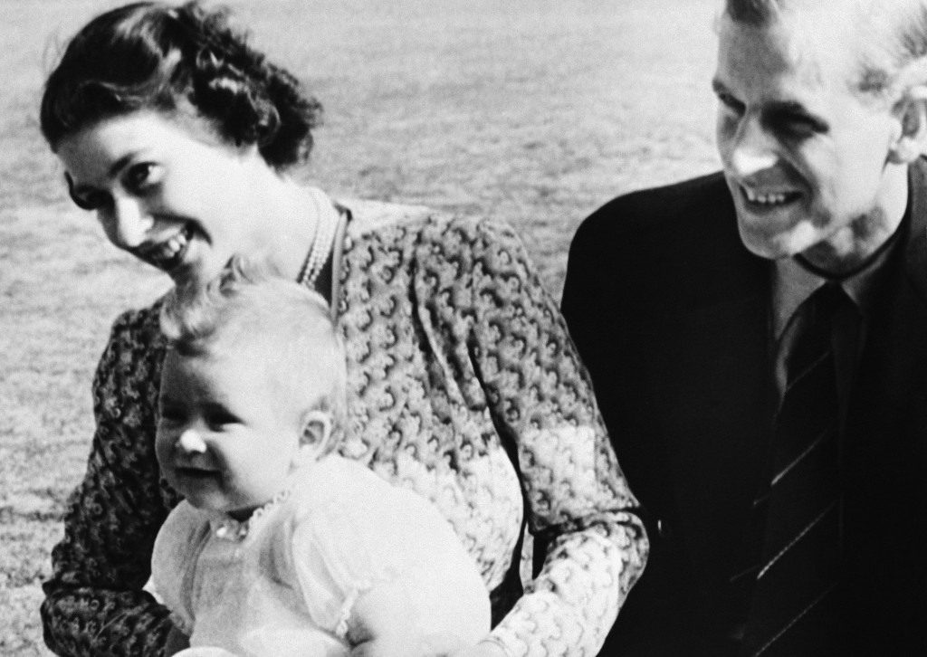 FILE - In this July 18, 1949 file photo, Britain's Prince Charles, foreground left, the eight-month-old son of Princess Elizabeth of England, left, an