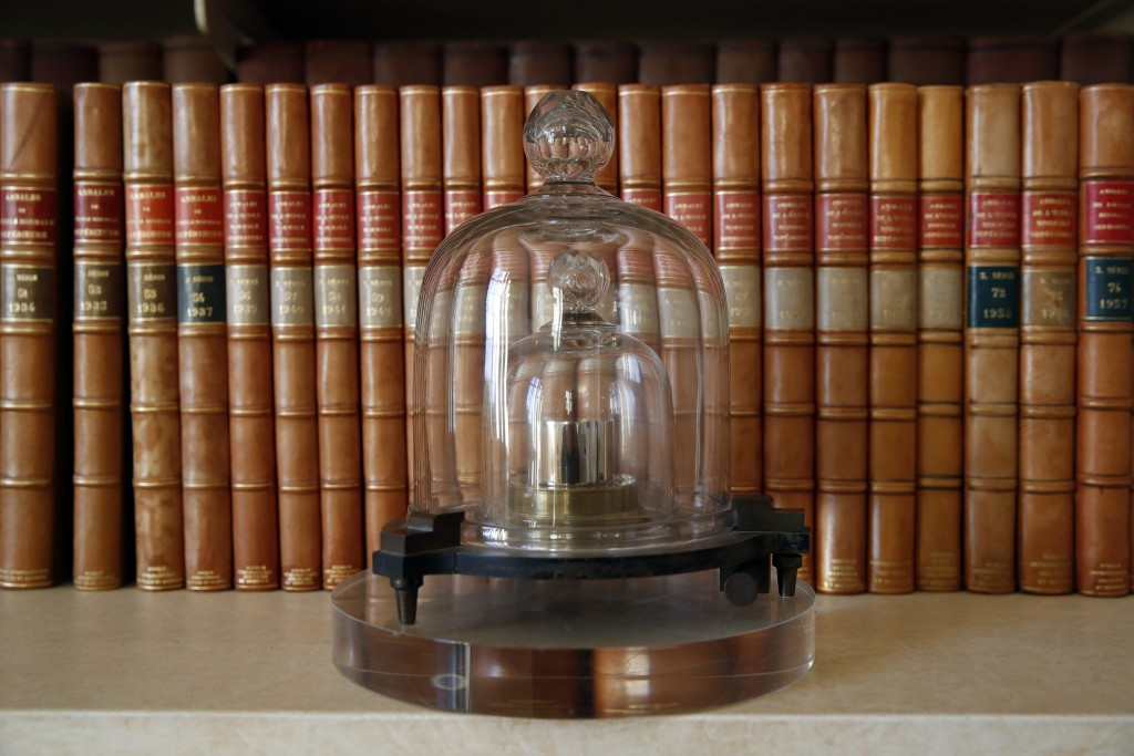 In this photo taken Wednesday, Oct. 17, 2018., a replica of the International Prototype Kilogram is pictured at the International Bureau of Weights an...