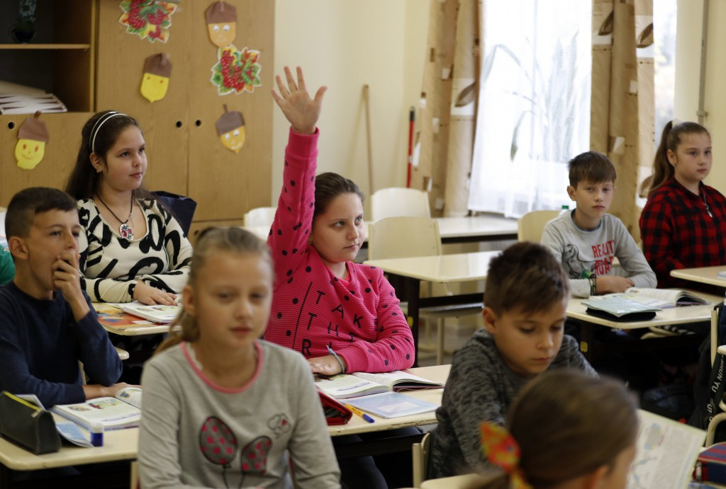 In this Friday, Oct. 19, 2018 photograph, children attend class at the Velyka Dobron High School in Velyka Dobron, Ukraine. A new education law that c...