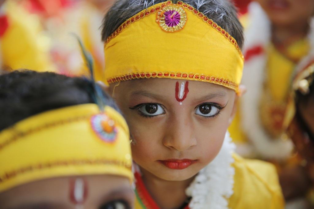 In this Wednesday, Nov. 14, 2018, file photo, children wait to perform on the birth anniversary of the country's first prime minister Jawaharlal Nehru...