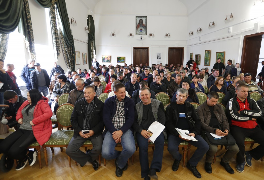 In this Friday, Oct. 19, 2018 photograph, farmers from the Hungarian minority in Ukraine attend a ceremony distributing agricultural subsidies from th...