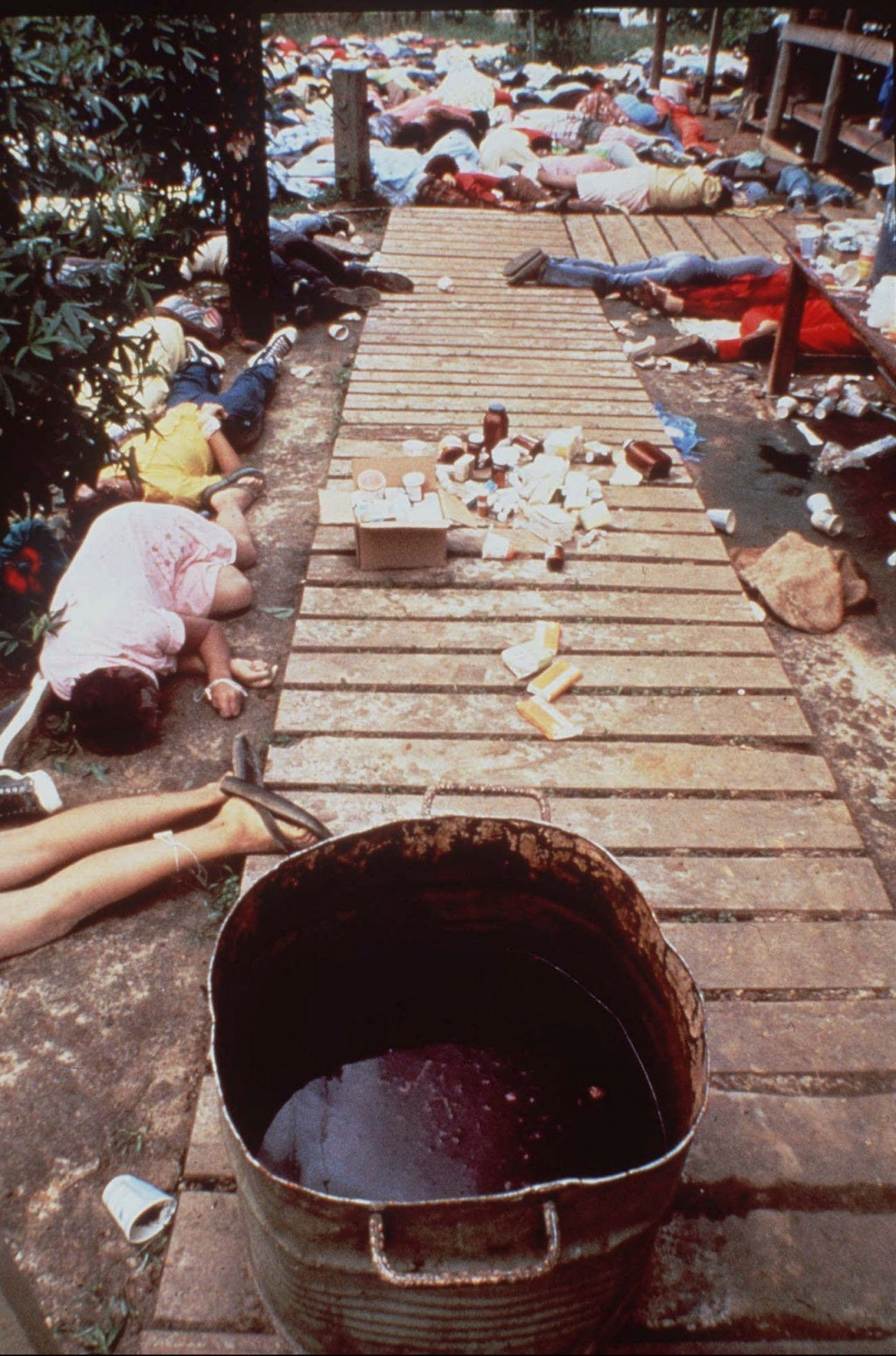 FILE - In this Nov. 20, 1978 file photo, a vat that contained a drink laced with deadly cyanide sits on a sidewalk at Peoples Temple in Jonestown, Guy