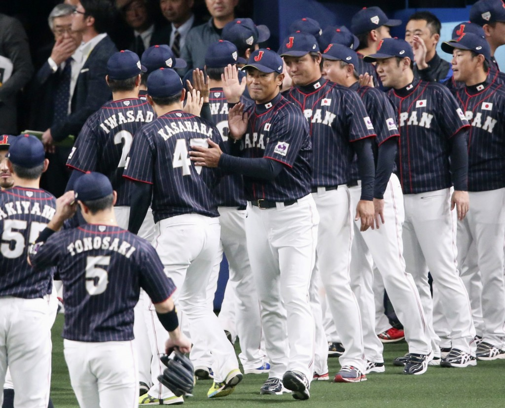 All Japan manager Atsunori Inaba, center, welcomes his players after beating MLB All-Stars 4-1 in Game 6 at their All-Stars Series baseball at Nagoya