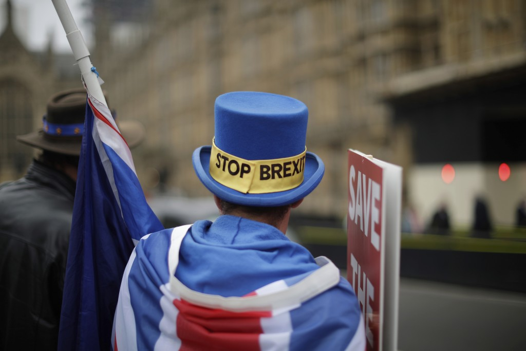 Anti-Brexit supporter Steve Bray from south Wales, protests outside the Houses of Parliament in London, Thursday Nov. 15, 2018. Leading Brexiteer Jaco...