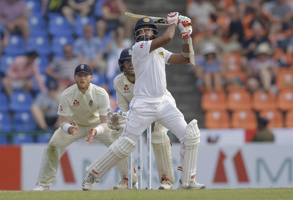 Sri Lanka's Dilruwan Perera plays a shot during the second day of the second test cricket match between Sri Lanka and England in Pallekele, Sri Lanka,...