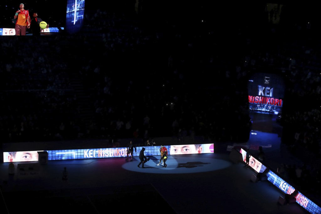 Japan's Kei Nishikori enters the court for the men's singles match against Austria's Dominic Thiem on day five of the ATP Finals at The O2 Arena, Lond