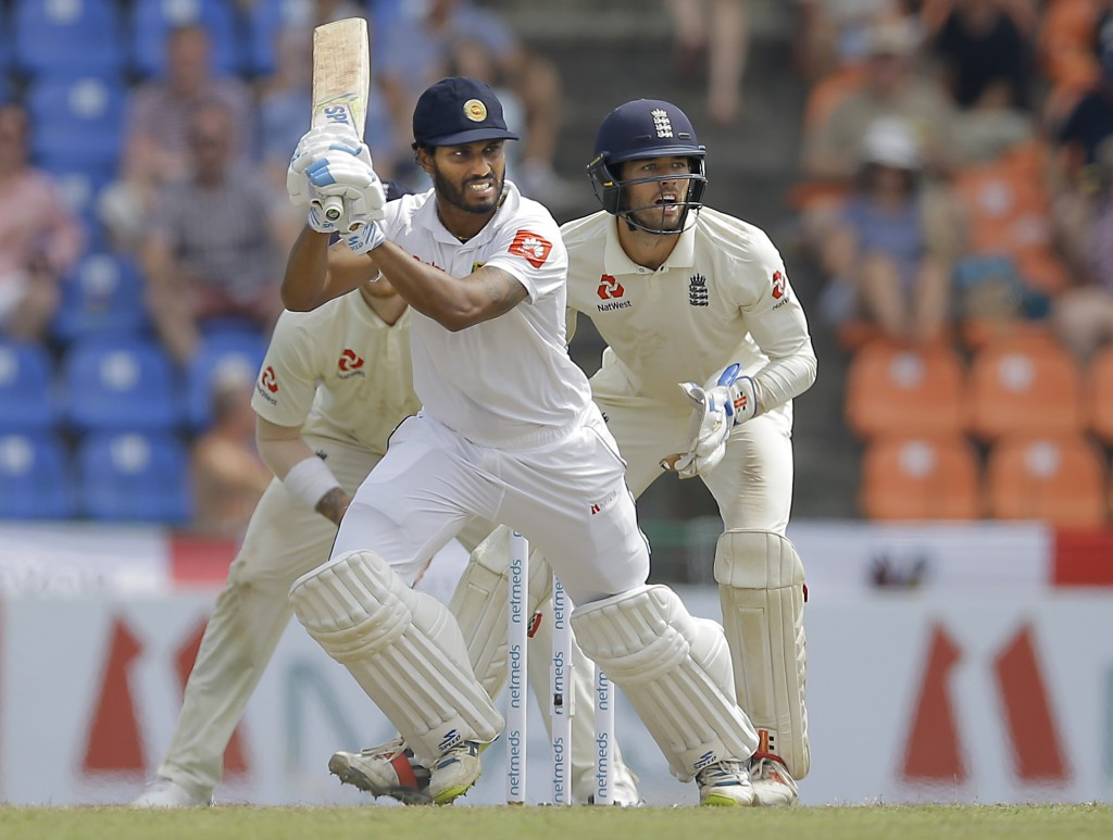 Sri Lanka's Roshen Silva plays a shot as England's wicketkeeper Ben Foakes watches during the second day of the second test cricket match between Sri ...