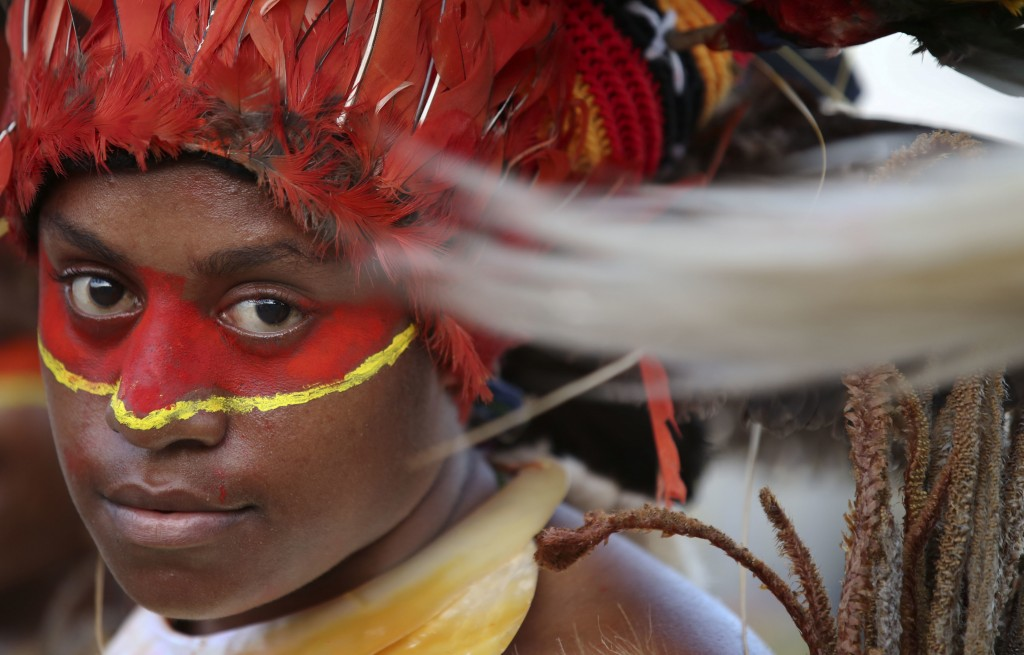 In this Thursday, Nov. 15, 2018, file photo, dancers in traditional dress wait for the arrival of Chinese President Xi Jinping in Port Moresby, Papua
