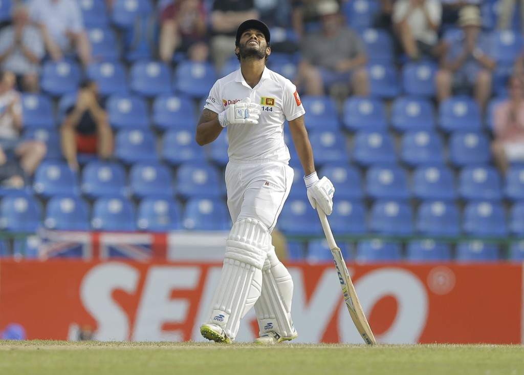Sri Lanka's Roshen Silva looks skywards scoring a half century during the second day of the second test cricket match between Sri Lanka and England in